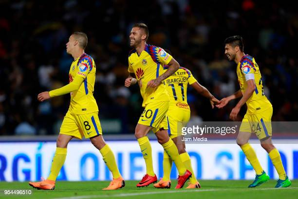 Jeremy Menez del America celebrates after scoring the fourth goal of his team during the quarter finals first leg match between Pumas UNAM and...