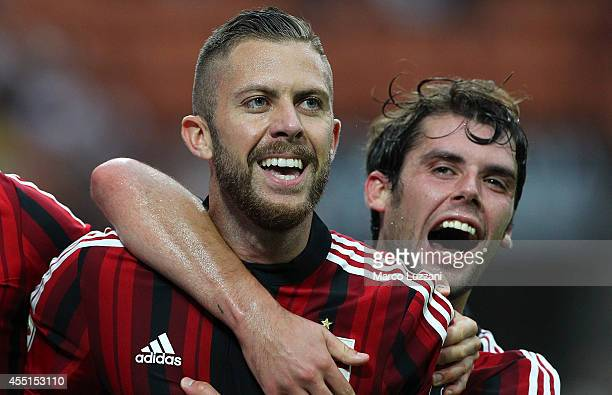 Jeremy Menez of AC Milan celebrates with his teammate Andrea Poli after scoring his goal during the Serie A match between AC Milan and SS Lazio at...