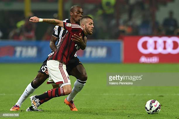 Jeremy Menez of AC Milan competes with Angelo Ogbonna of Juventus FC during the Serie A match between AC Milan and Juventus FC at Stadio Giuseppe...