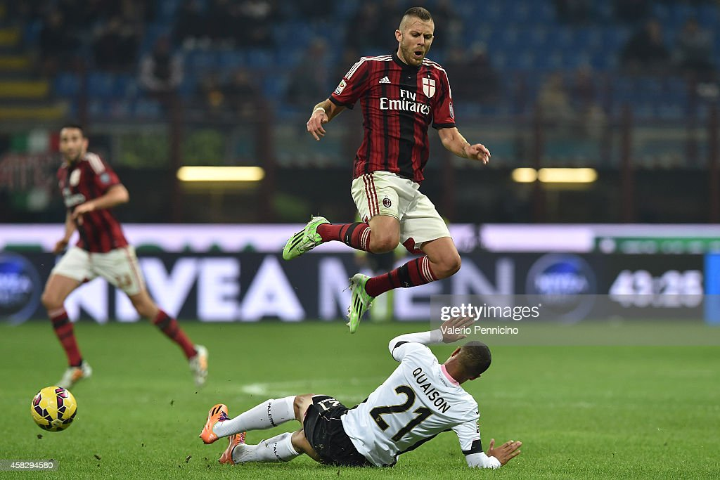 Jeremy Menez (R) of AC Milan is tackled by Robin Quaison of US Citta di Palermo during the Serie A match between AC Milan and US Citta di Palermo at Stadio Giuseppe Meazza on November 2, 2014 in Milan, Italy.