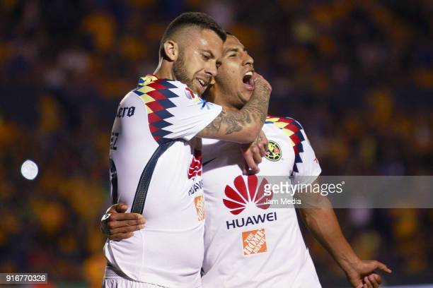 Jeremy Menez of America celebrates with Cecilio Dominguez after scoring the equalizer during the 6th round match between Tigres UANL and America as...