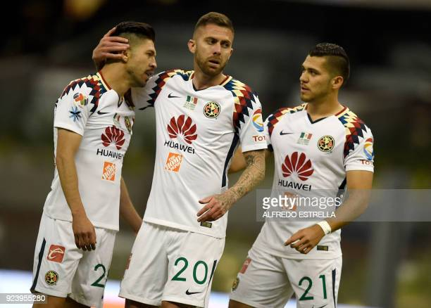 Jeremy Menez of America confers with teammates Oribe Peralta and Henry Martin during their Mexican Clausura 2018 tournament football match against...