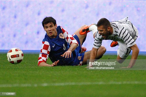 Jeremy Menez of France is tackled by Dejan Lovren of Croatia during the International friendly match between France and Croatia at Stade de France at...