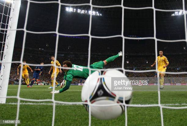 Jeremy Menez of France scores past Andriy Pyatov of Ukraine during the UEFA EURO 2012 group D match between Ukraine and France at Donbass Arena on...