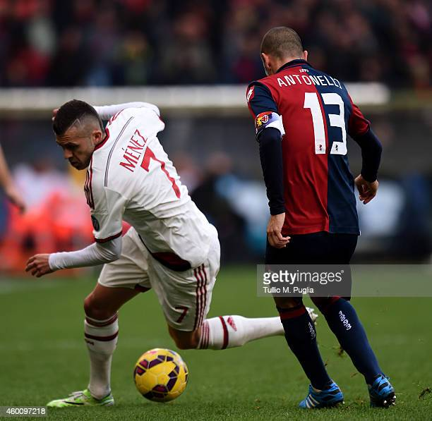 Jeremy Menez of Milan and Luca Antonelli of Genoa compete for the ball during the Serie A match between Genoa CFC and AC Milan at Stadio Luigi...