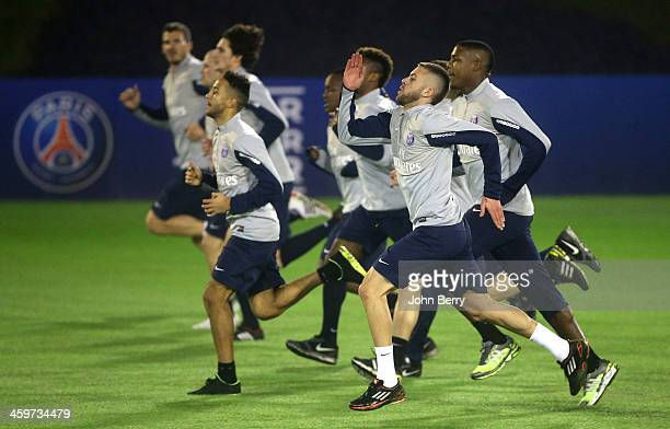 Jeremy Menez of PSG and his teammates warm up during the first practice of the Paris SaintGermain Training Camp the Qatar Winter Tour held at the...