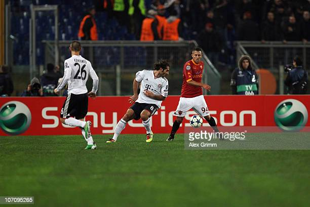 Jeremy Menez of Roma is challenged by Hamit Altintop and Diego Contento of Muenchen in front of the Sony Ericsson advertisement board during the UEFA...