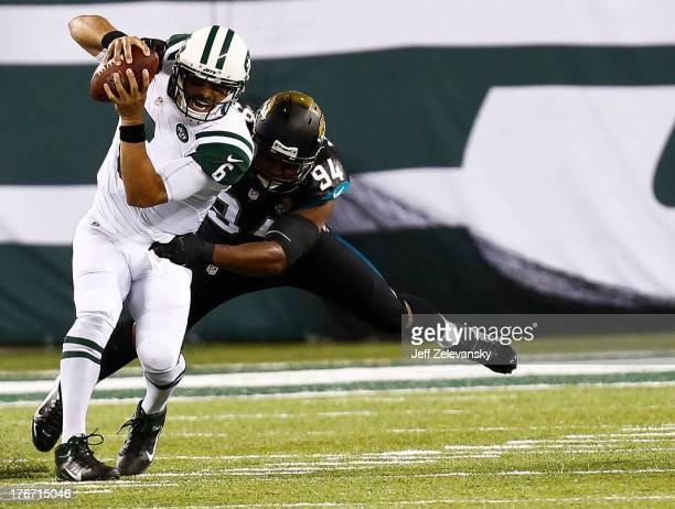Jeremy Mincey of the Jacksonville Jaguars sacks Mark Sanchez of the New York Jets during their preseason game at MetLife Stadium on August 17 2013 in...