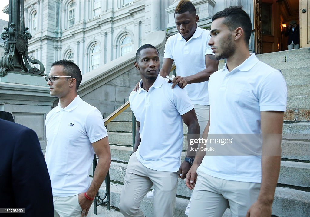 Jeremy Morel, Claudio Beauvue, Clinton Njie and Rachid Ghezzal of Lyon leave the ceremony presenting the 2015 Trophee des Champions between Paris Saint-Germain (PSG) and Olympique Lyonnais (OL) at Montreal City Hall on July 31, 2015 in Montreal, Quebec, Canada.