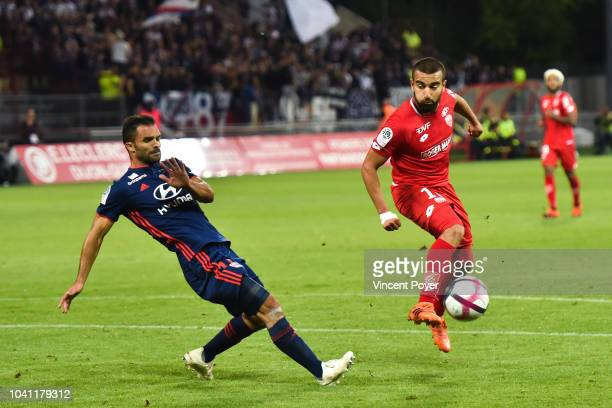 Jeremy Morel of Lyon and Naim Sliti of Dijon during the Ligue 1 match between Dijon and Lyon at Stade Gaston Gerard on September 26 2018 in Dijon...