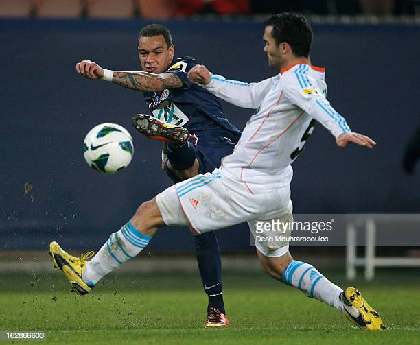 Jeremy Morel of Marseille attempts to sto the cross from Gregory Van Der Wiel of PSG during the French Cup match between Paris SaintGermain FC and...