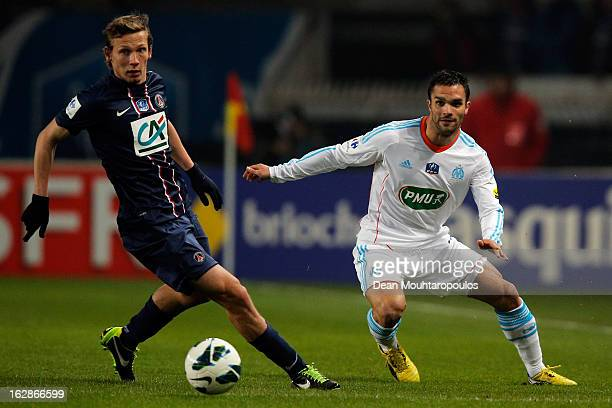 Jeremy Morel of Marseille passes the ball in front of Clement Chantome of PSG during the French Cup match between Paris SaintGermain FC and Marseille...