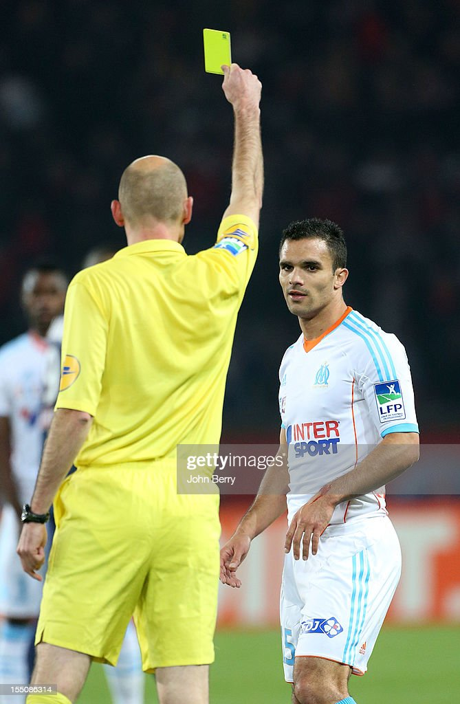 Jeremy Morel of Olympique de Marseille gets a yellow card during the french eight-finals League Cup match between Paris Saint Germain - PSG - and Olympique de Marseille - OM - 2-0 at the Parc des Princes Stadium on October 31, 2012 in Paris, France.