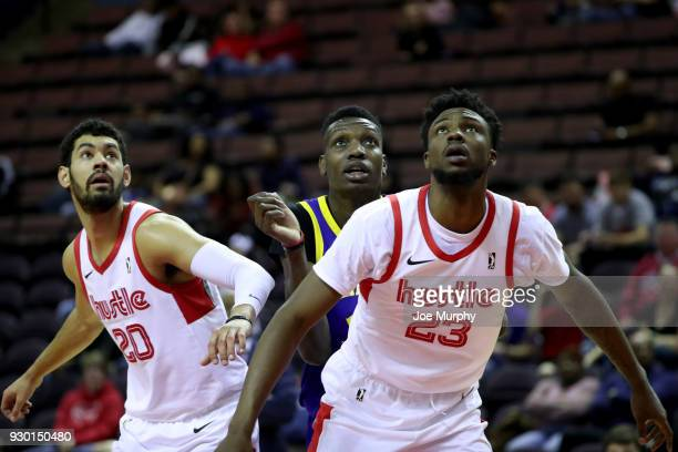 Jeremy Morgan and Kuran Iverson of the Memphis Hustle box out Chris Boucher of the Santa Cruz Warriors during an NBA GLeague game on March 10 2018 at...