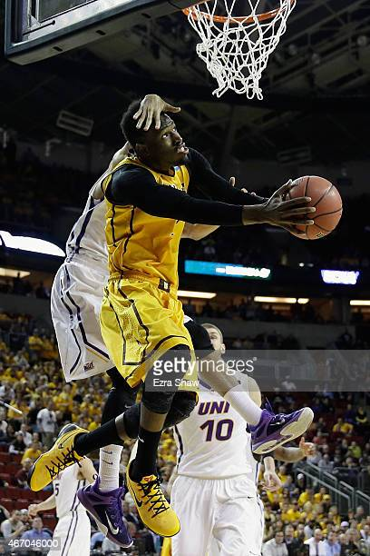 Jeremy Morgan of the Northern Iowa Panthers jumps to block a shot by Derek Cooke Jr #11 of the Wyoming Cowboys during the first half of their game in...