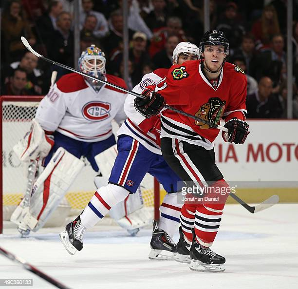 Jeremy Morin of the Chicago Blackhawks looks for a pass against the Montreal Canadiens at the United Center on April 9 2014 in Chicago Illinois The...