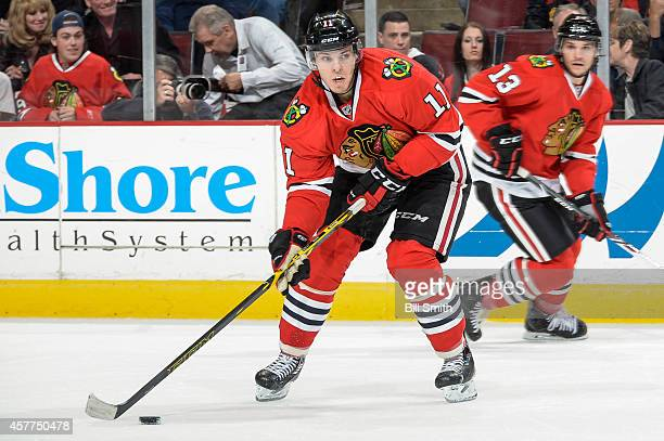 Jeremy Morin of the Chicago Blackhawks receives the puck during the NHL game against the Buffalo Sabres on October 11 2014 at the United Center in...