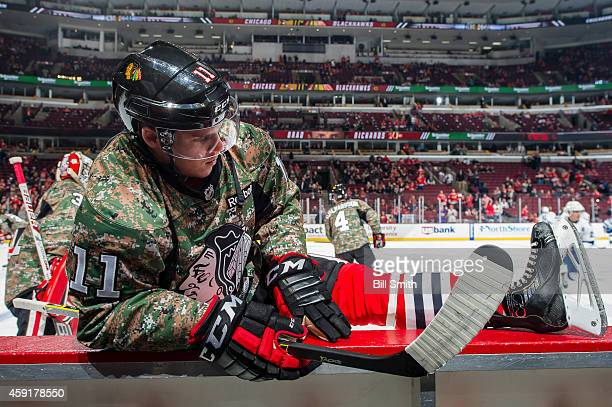 Jeremy Morin of the Chicago Blackhawks stretches during warmups prior to the NHL game against the Tampa Bay Lightning on November 11 2014 at the...