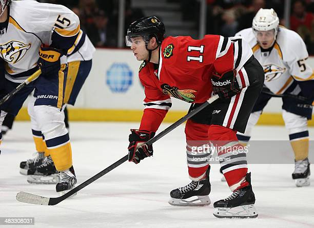 Jeremy Morin of the Chicago Blackhawks waits for a faceoff against the Nashville Predators at the United Center on March 23 2014 in Chicago Illinois...