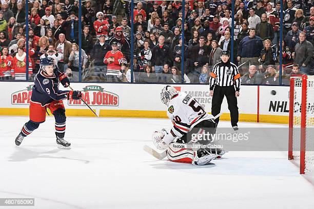 Jeremy Morin of the Columbus Blue Jackets scores a shootout goal against Corey Crawford of the Chicago Blackhawks on December 20 2014 at Nationwide...