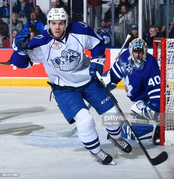 Jeremy Morin of the Syracuse Crunch skates by Garret Sparks of the Toronto Marlies during AHL game action on February 4 2017 at Ricoh Coliseum in...