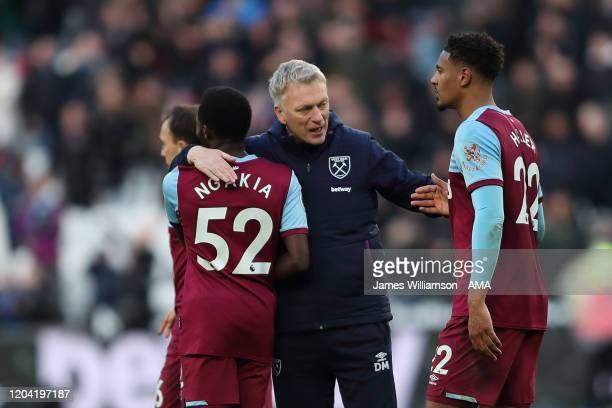 Jeremy Ngakia and West Ham United manager / head coach David Moyes and Sebastien Haller at full time of the Premier League match between West Ham...