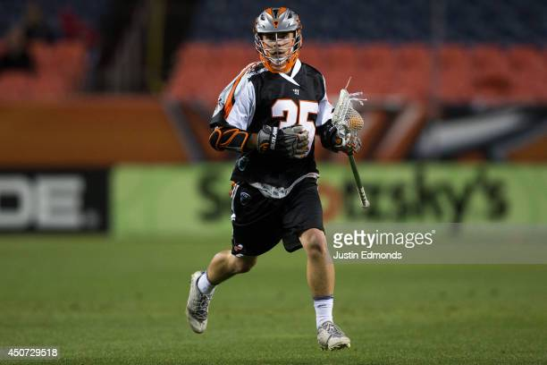 Jeremy Noble of the Denver Outlaws in action against the New York Lizards at Sports Authority Field at Mile High on June 14 2014 in Denver Colorado...