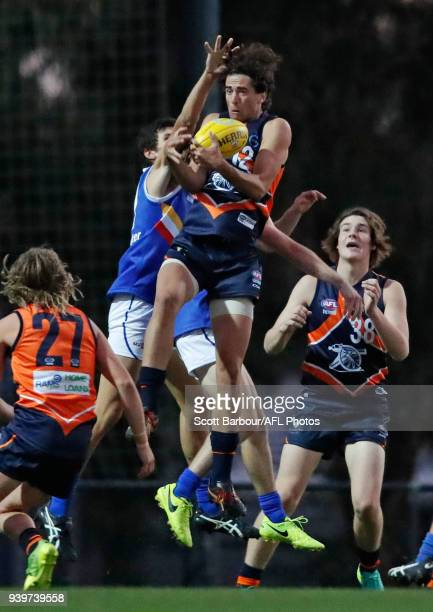 Jeremy O'Sullivan of the Calder Cannons marks the ball during the round two TAC Cup match between Calder and Eastern Ranges at RAMS Arena on March 29...