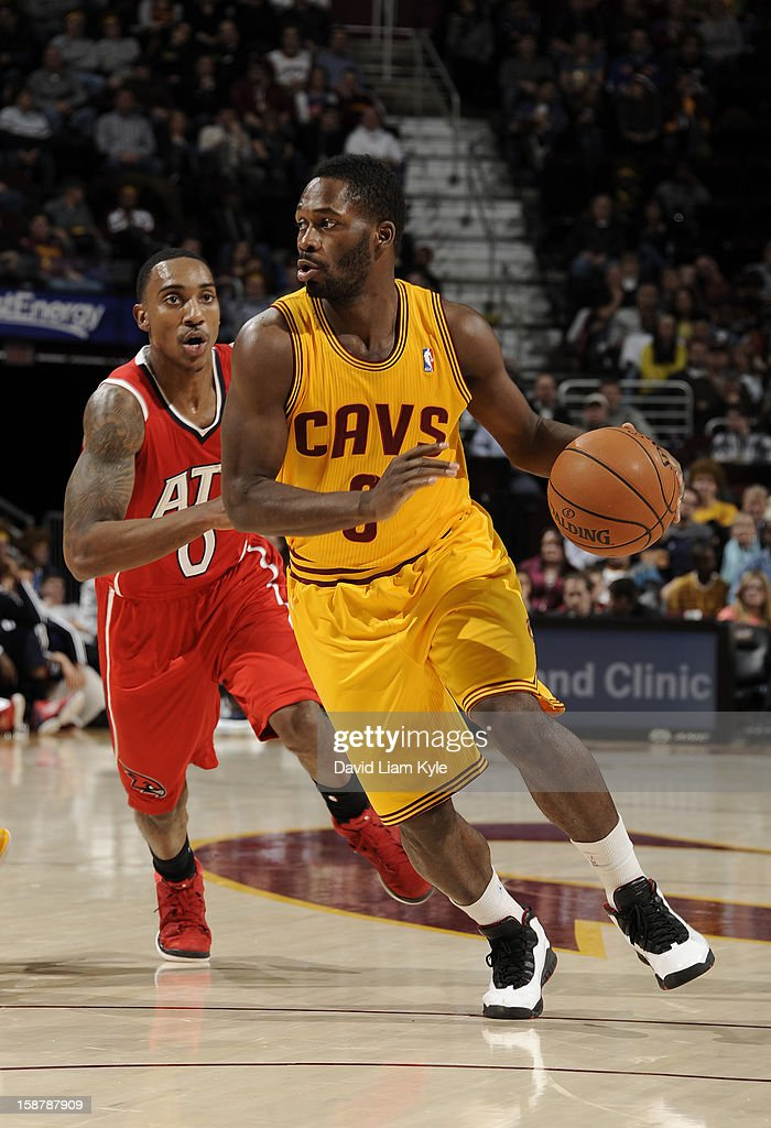 Jeremy Pargo #8 of the Cleveland Cavaliers drives to the hoop against Jeff Teague #0 of the Atlanta Hawks at The Quicken Loans Arena on December 28, 2012 in Cleveland, Ohio.