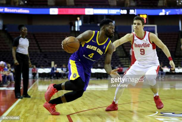 Jeremy Pargo of the Santa Cruz Warriors handles the ball against Dusty Hannahs of the Memphis Hustle during an NBA GLeague game on March 10 2018 at...