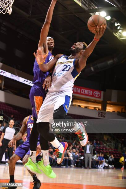 Jeremy Pargo of the Santa Cruz Warriors shoots against Tariq Owens of the Northern Arizona Suns on December 15 at the Findlay Toyota Center in...