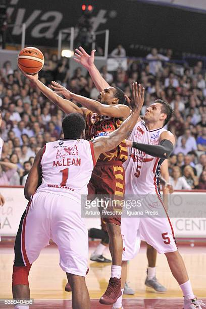 Jeremy Pargo of Umana competes with Jamel McLean and Alessandro Gentile of EA7 duriing the LegaBsaket Serie A match between Reyer Umana Venezia and...