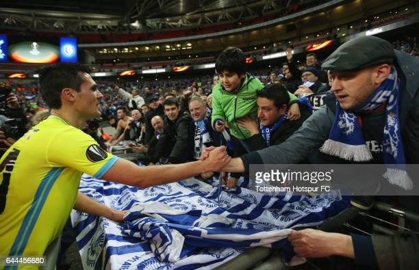 Jeremy Perbet of Gent celebrates with fans after the UEFA Europa League Round of 32 second leg match between Tottenham Hotspur and KAA Gent at...