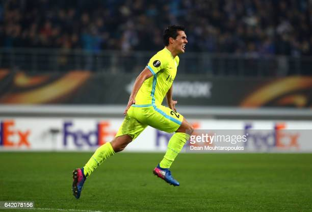 Jeremy Perbet of KAA Gent celebrates after scoring his sides first goal during the UEFA Europa League Round of 32 first leg match between KAA Gent...