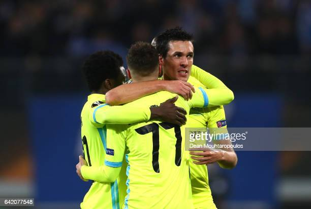 Jeremy Perbet of KAA Gent celebrates with team mates after scoring his sides first goal during the UEFA Europa League Round of 32 first leg match...