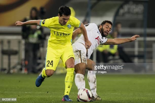 Jeremy Perbet of KAA Gent Mousa Dembele of Tottenham Hotspur FCduring the UEFA Europa League round of 16 match between KAA Gent and Tottenham Hotspur...