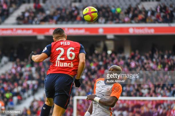 Jeremy Pied of Lille and Ambroise Oyongo Bitolo of Montpellier during the Ligue 1 match between Lille and Montpellier at Stade Pierre Mauroy on...