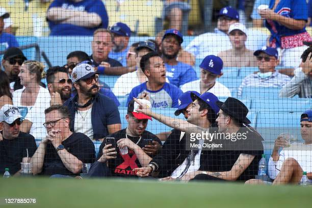 Jeremy Piven and G-Eazy attend the game between the Los Angeles Dodgers and the Chicago Cubs at Dodger Stadium on June 27, 2021 in Los Angeles,...