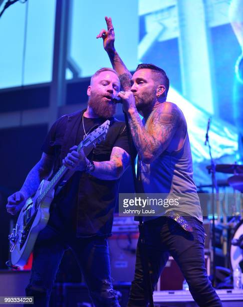 Jeremy Popoff and A Jay Popoff of Lit performs during the GenX summer tour at Miramar Regional Park Amphitheater on July 3 2018 in Miramar Florida