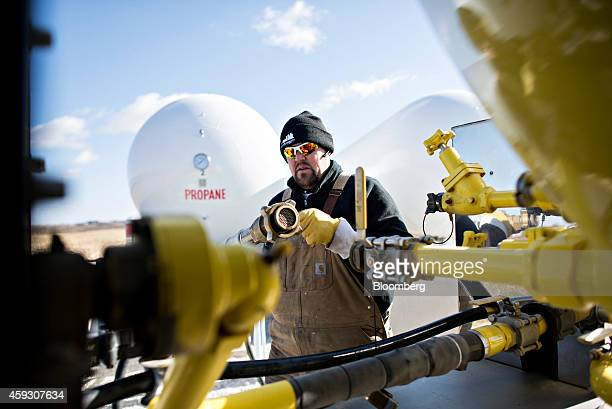 Jeremy Rediger a propane delivery driver for Michlig Energy disconnects a filler hose after filling his truck with propane in Manlius Illinois US on...