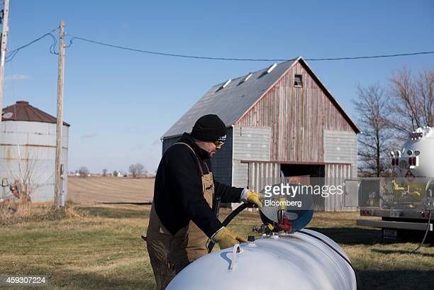Jeremy Rediger a propane delivery driver for Michlig Energy makes a delivery to a residence outside Annawan Illinois US on Thursday Nov 20 2014...