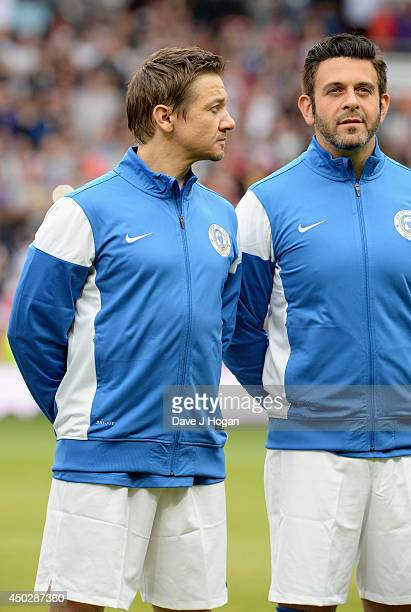 Jeremy Renner and Adam Richman of the Rest of the World in the team line up ahead of Soccer Aid 2014 at Old Trafford on June 8 2014 in Manchester...