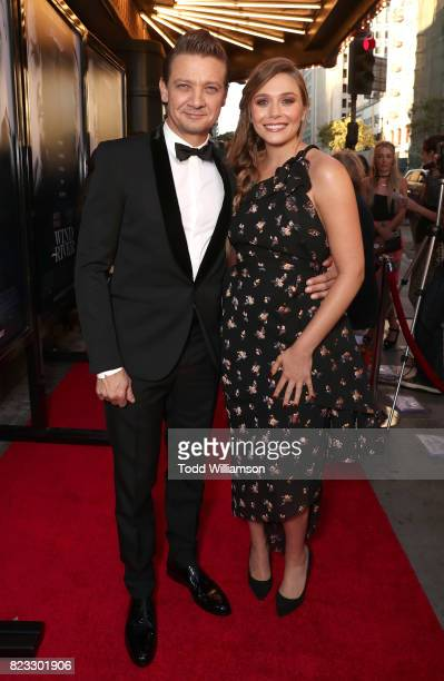 Jeremy Renner and Elizabeth Olsen attend the premiere of The Weinstein Company's 'Wind River' at The Theatre at Ace Hotel on July 26 2017 in Los...