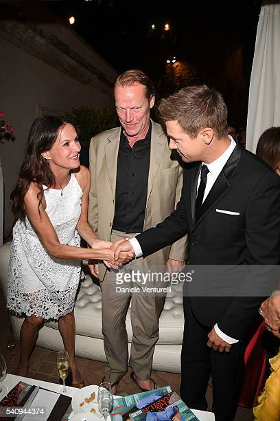 Jeremy Renner Iain Glen and Charlotte Emmerson attend Baume Mercier 62 Taormina Film Fest on June 17 2016 in Taormina Italy
