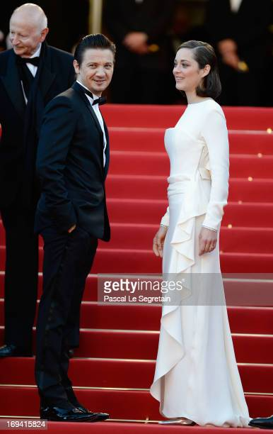 LR Jeremy Renner Marion Cotillard and Chairman of the Cannes Film Festival Gilles Jacob attend 'The Immigrant' Premiere during the 66th Annual Cannes...