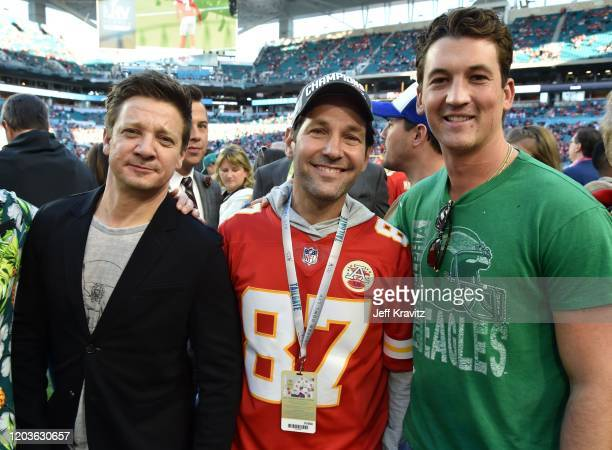 Jeremy Renner Paul Rudd and Miles Teller attend Super Bowl LIV at Hard Rock Stadium on February 02 2020 in Miami Gardens Florida