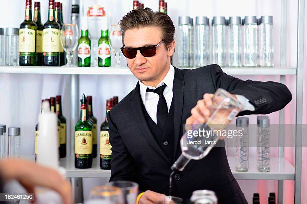 Jeremy Renner poses in the Kindle Fire HD and IMDb Green Room during the 2013 Film Independent Spirit Awards at Santa Monica Beach on February 23...