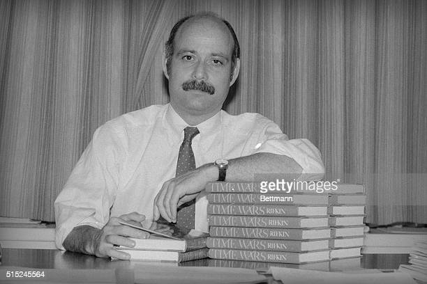 """Jeremy Rifkin, president of the Foundation of Economic Trends, sits with copies of his book """"Time Wars."""" Rifkin is concerned that whole sections of..."""