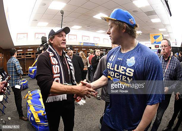 Jeremy Roenick congratulates Vladimir Tarasenko of the St Louis Blues after beating the Chicago Blackhawks 41 during the 2017 Bridgestone NHL Winter...