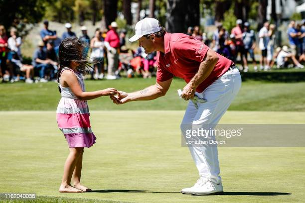 Jeremy Roenick gives his golf ball to a little girl after completing the final round of the American Century Championship at Edgewood Tahoe Golf...